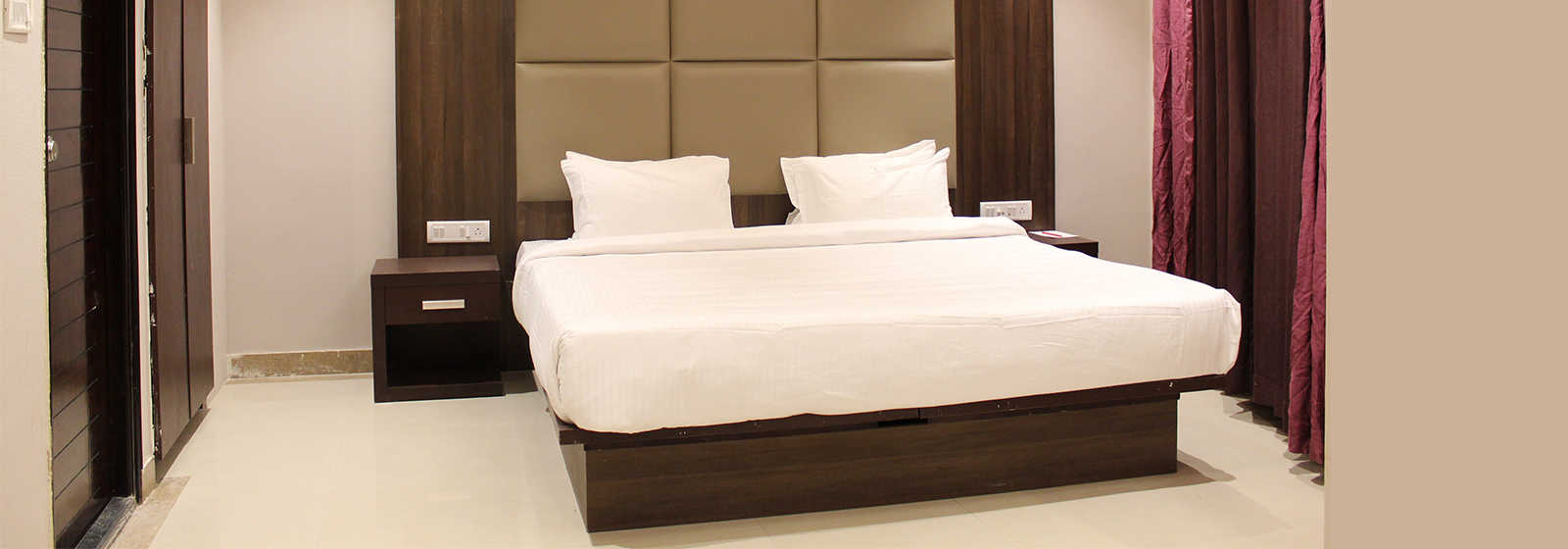 Super Deluxe Room with a king bed at The Byke Signature, a business hotel in Whitefield, Bangalore.