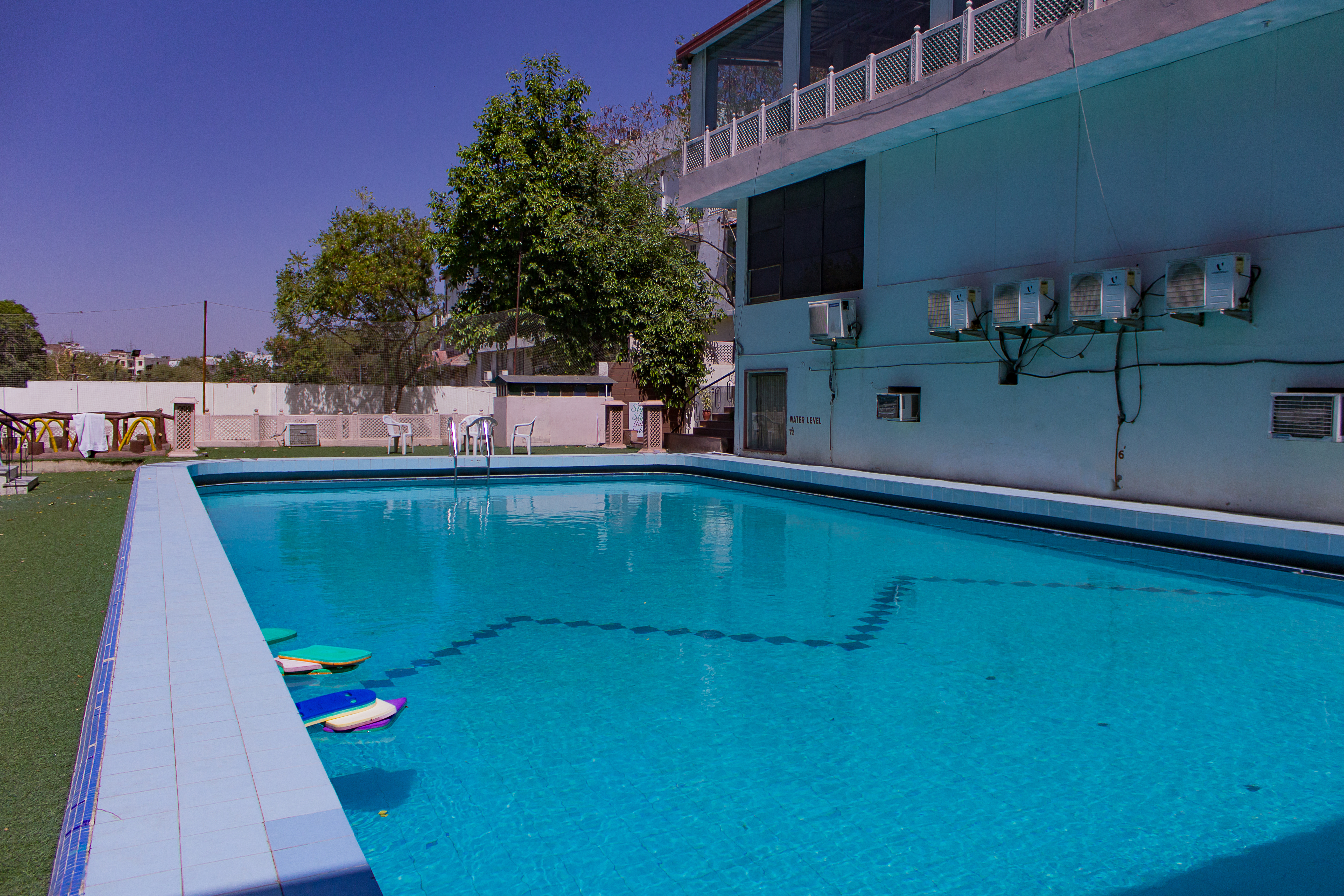 Big swimming pool in Jaipur at The Byke Grassfield Resort.