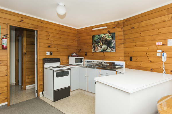 Fully equipped kitchen with stove